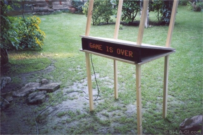 Game over (A játéknak vége) - Wood table, color cells with text - 2002